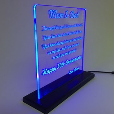LED lights on acrylic sign with laser etching